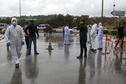 Tunisian forensic police investigate the site of an attack on Tunisian National Guard officers on September 6, 2020, in Sousse, south of the capital Tunis. [BECHIR TAIEB/AFP via Getty Images]
