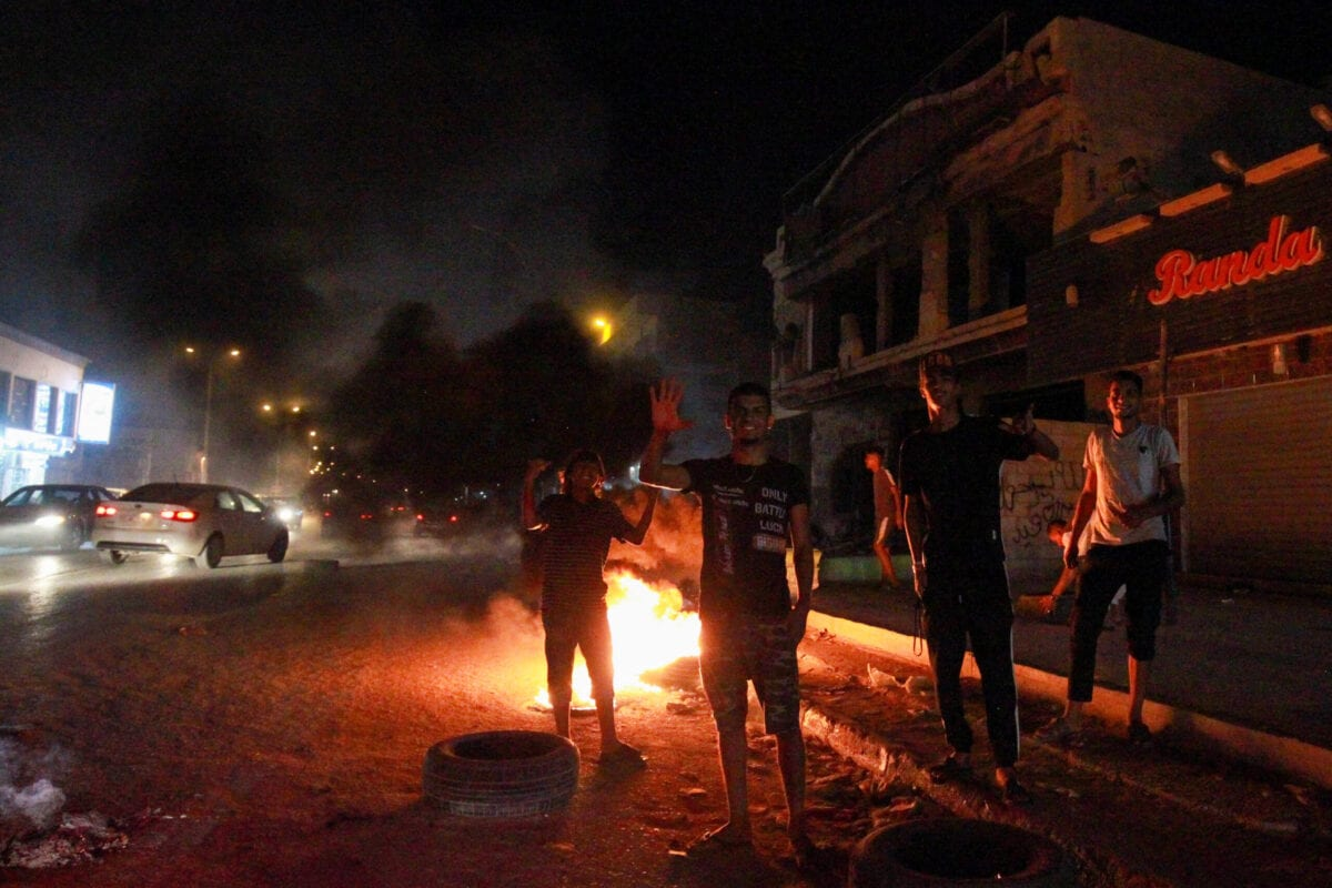 Libyan youth block a road with burning tyres in Libya's eastern coastal city of Benghazi on September 12, 2020, as they protest the poor public services and living conditions [ABDULLAH DOMA/AFP via Getty Images]