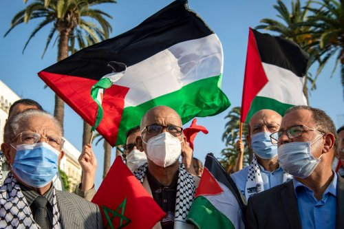 Moroccans wave the Palestinian flag during a demonstration in the capital Rabat on September 18, 2020, to denounce the Israeli normalisation deals with the United Arab Emirates and Bahrain. (Photo by FADEL SENNA / AFP) (Photo by FADEL SENNA/AFP via Getty Images)