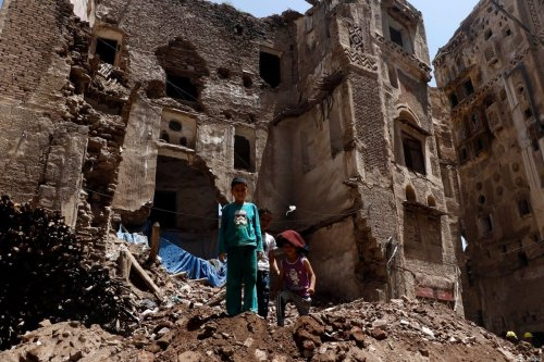 SANA'A, YEMEN - AUGUST 13: Children stand on the rubble of a historic building after it was collapsed partially due to the heavy rains in the UNESCO World Heritage-listed Old Sana'a City, on August 13, 2020 in Sana'a, Yemen [Mohammed Hamoud/Getty Images]