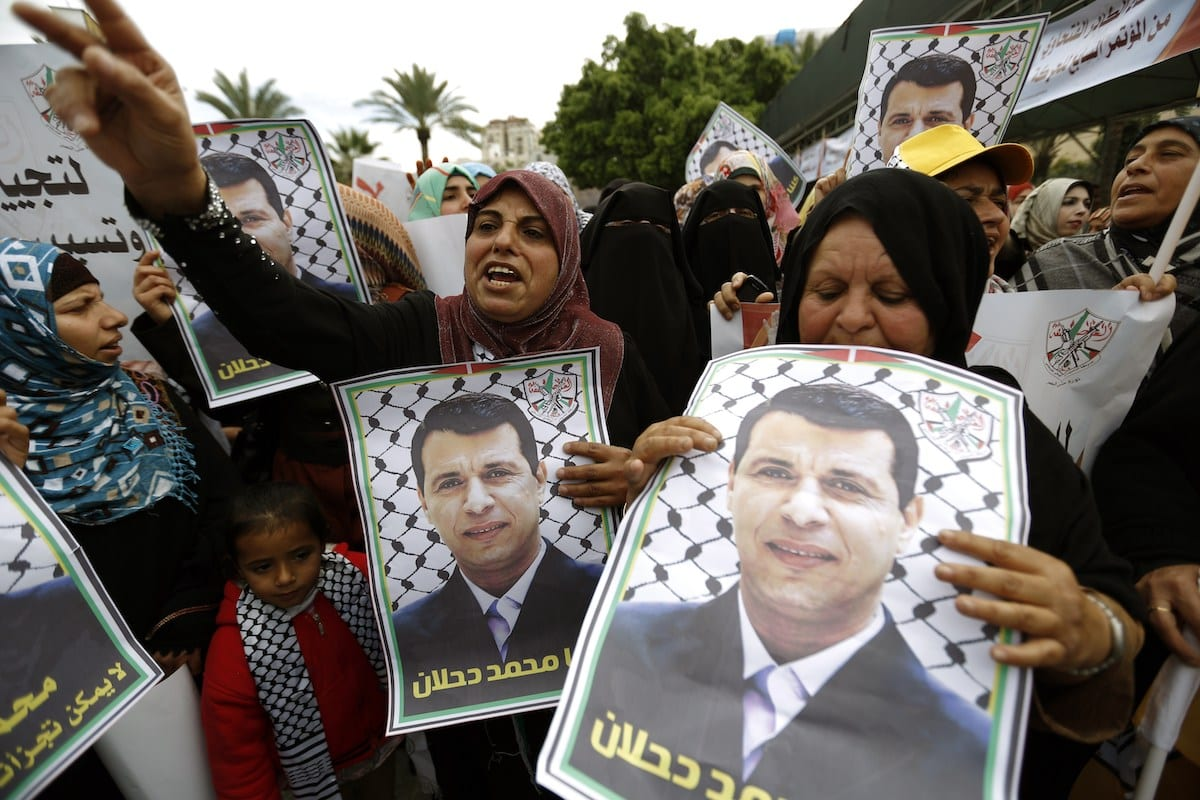 Palestinian supporters of dismissed senior Fatah leader Mohammed Dahlan shout slogans during a protest to support him on 18 December 2014 in Gaza City. [MOHAMMED ABED/AFP via Getty Images]