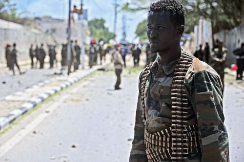 A Somali security force member looks on at the scene of a suicide car bomb blast on August 30, 2016 in Mogadishu [MOHAMED ABDIWAHAB/AFP via Getty Images]