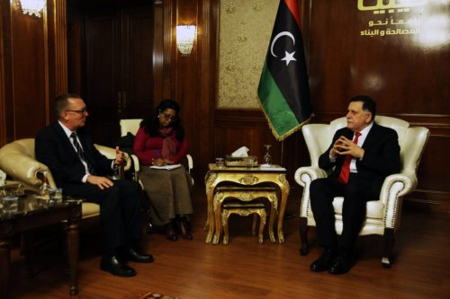 Libya's unity government Prime Minister Fayez al-Sarraj (R) meets with UN Undersecretary-General for Political Affairs Jeffrey Feltman (L) in the capital Tripoli on 10 January 2018 [STR/AFP via Getty Images]