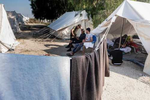 Refugees seen at a camp in Cyprus on 5 November 2019 [IAKOVOS HATZISTAVROU/AFP/Getty Images]