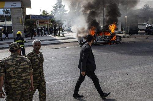 BARDA, AZERBAIJAN - OCTOBER 28: Smoke and flares rises from a burning car after Armenian forces hit city center of Azerbaijan's Barda on October 28, 2020. ( Arif Hüdaverdi Yaman - Anadolu Agency )