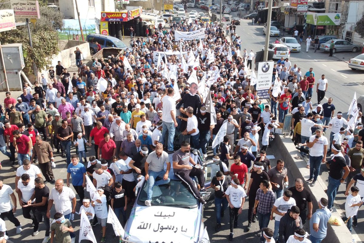 Palestinians gather to protest against comments by French President Emmanuel Macron defending cartoons of the Prophet Mohammed in Qalandiya refugee camp, located between Jerusalem and West Bank on October 30, 2020 [Issam Rimawi - Anadolu Agency]