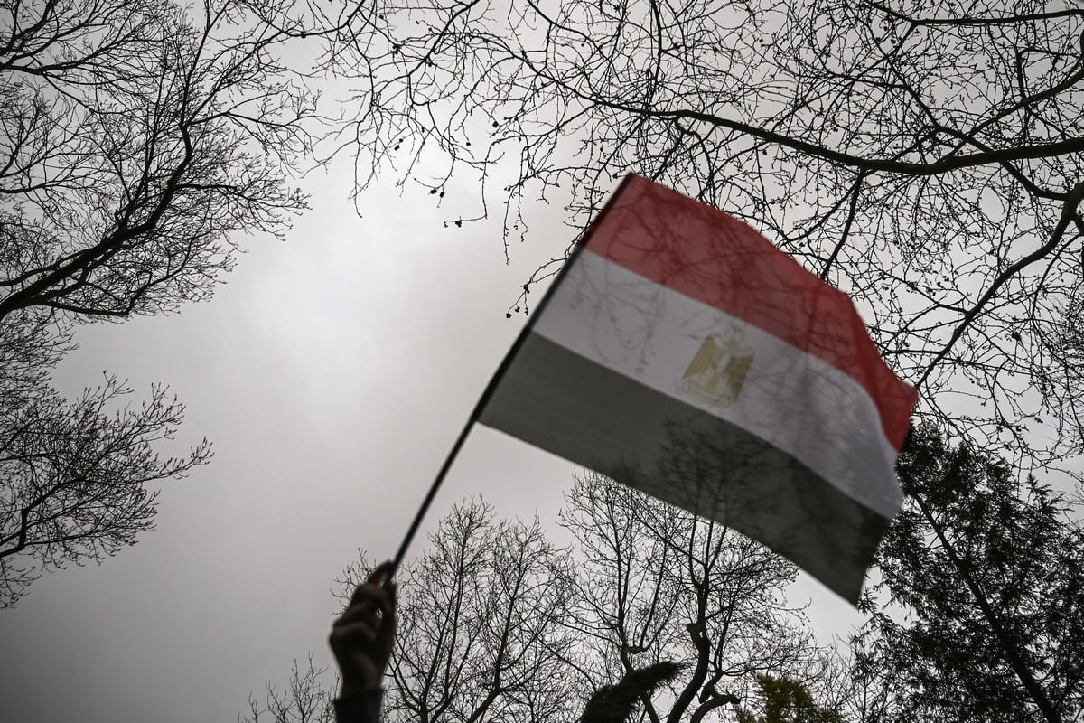 A woman waves an Egyptian flag in front of the Egyptian consulate in Istanbul on march 2, 2019 during a demonstration against death penalties in Egypt after the recent execution of nine men. [OZAN KOSE/AFP via Getty Images]