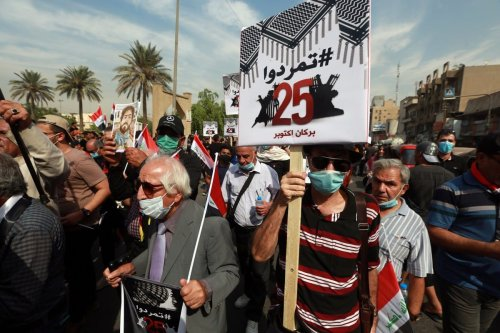 Iraqi demonstrators gather at Tahrer square in Baghdad, Iraq on 25 October 2020 [Murtadha Al-Sudani/Anadolu Agency]