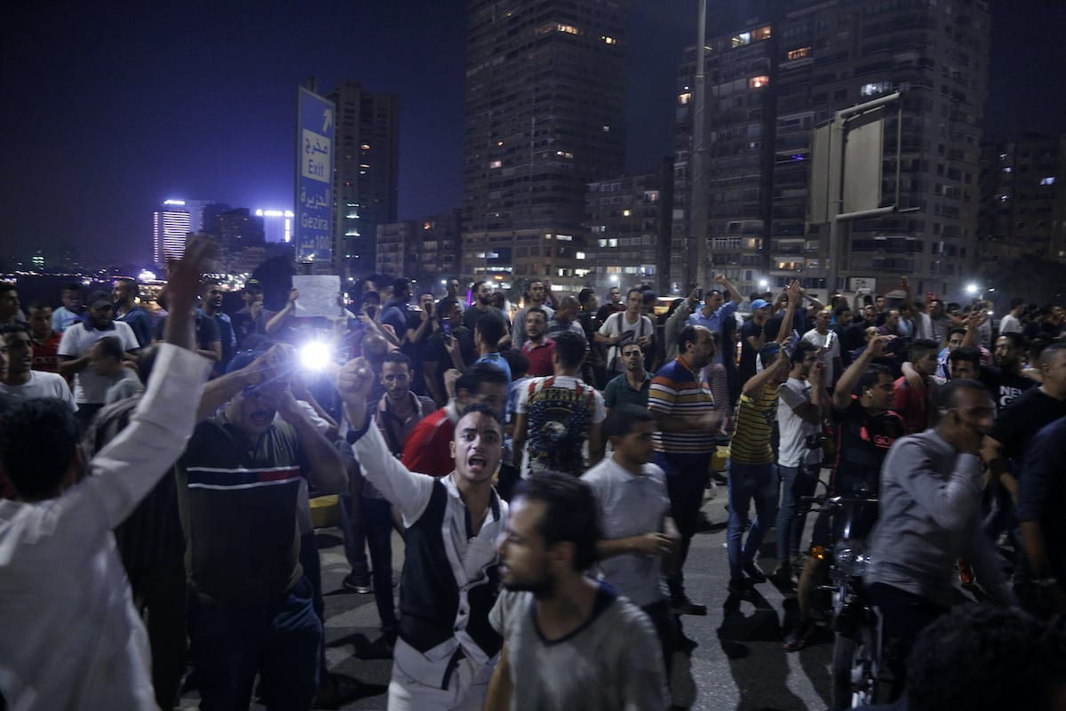 Egyptian protesters shout slogans as they take part in a protest calling for the removal of President Abdel Fattah al-Sisi in Cairo's downtown on 20 September 2019. [STR/AFP via Getty Images]
