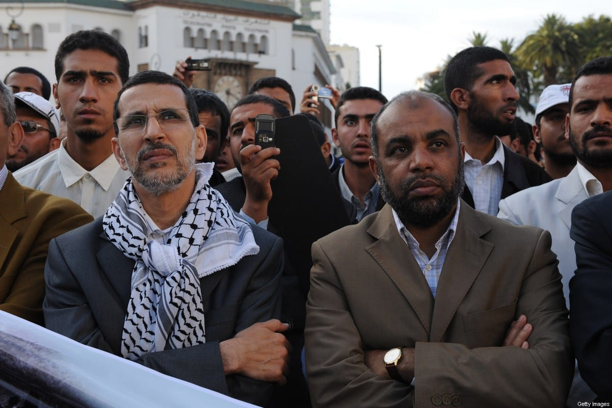 """Al Adl Wal Ihssane (Justice and Charity party) spokesman Fathallah Arsalane (R) and Secretary General of the Islamic, Justice and Development Party (PJD), Saadeddine El Othmani (L) attend a march on 15 May 2008 in Rabat marking the 60 year anniversary of Naqba or """"catastrophe"""" that lead to the expulsion or flight of some 760,000 people from what was once Palestine and consequently the birth of the Jewish state of Israel. [ABDELHAK SENNA/AFP via Getty Images]"""