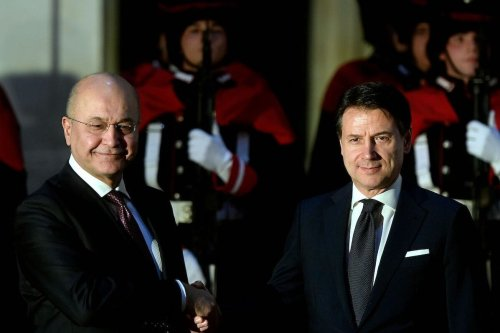 Italian Prime Minister Giuseppe Conte (R) shake hands with Iraqi President Barham Saleh as they meet at Palazzo Chigi in Rome on 24 January 2020. [FILIPPO MONTEFORTE/AFP via Getty Images]
