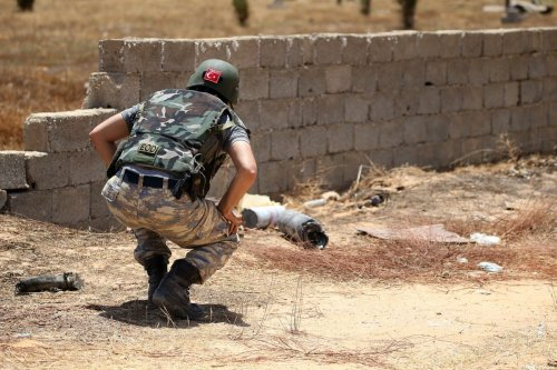 A Turkish deminer searches for landmines in the Salah al-Din area, south of the Libyan capital Tripoli, on June 15, 2020. - Human Rights Watch earlier this month accused pro-Haftar forces of laying Russian and Soviet-era landmines as they withdrew from Tripoli's southern districts. A team of Turkish deminers arrived in Tripoli last week to bring their expertise, under a broader military cooperation agreement signed late last year between Tripoli and Ankara. (Photo by Mahmud TURKIA / AFP) (Photo by MAHMUD TURKIA/AFP via Getty Images)