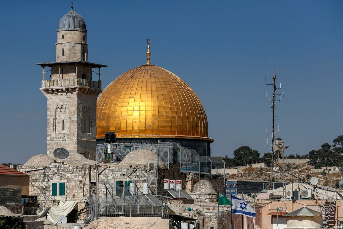 An Israeli flag flies in front of the Dome of the Rock mosque near the al-Aqsa mosque compound in Jerusalem's Old City, on August 24, 2020. (Photo by AHMAD GHARABLI / AFP) (Photo by AHMAD GHARABLI/AFP via Getty Images)