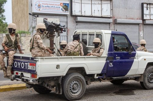 Forces loyal to Yemen's Southern Transitional Council (STC) deploy at the entrance of Aden International Airport of the southern Yemeni city on 27 August 2020. [SALEH AL-OBEIDI/AFP via Getty Images]