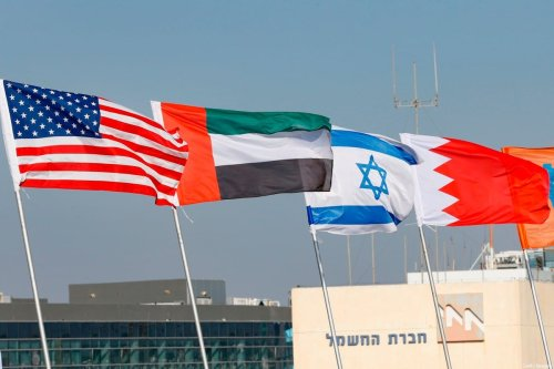 The national flags of (L-R) US, United Arab Emirates, Israel and Bahrain are flown along a road, in the resort city of Netanya in central Israel, on September 13, 2020. - The UAE and Bahrain will sign agreements to recognise Israel, on September 15. US President Donald Trump and Israeli Prime Minister Benjamin Netanyahu are to sign the Abraham accords -- a reference to the common traditions of Islam, Judaism and Christianity -- at a White House ceremony. (Photo by JACK GUEZ / AFP) (Photo by JACK GUEZ/AFP via Getty Images)