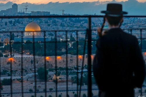 An Ultra Orthodox Jew looks from a spot on the Mount of Olives towards Jerusalem's Old City, with a view of the Dome of the Rock in the al-Aqsa mosque compound, on 23 September 2020 [AHMAD GHARABLI/AFP via Getty Images]
