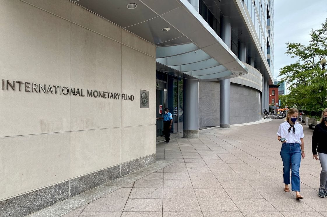 People are walking in front of the International Monetary Fund (IMF) building in Washington DC on 25 September 2020. [DANIEL SLIM/AFP via Getty Images]