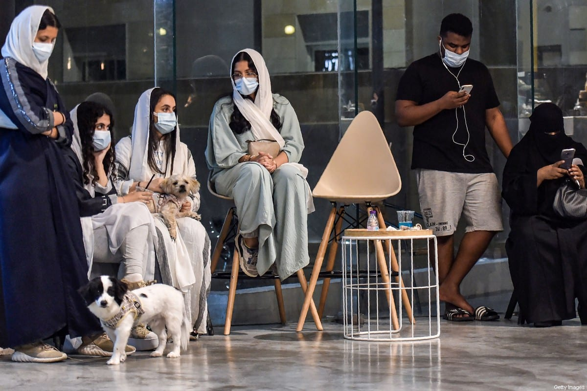 People sit at cafe in Saudi Arabia's eastern Gulf city of Khobar on September 25, 2020 [FAYEZ NURELDINE/AFP via Getty Images]