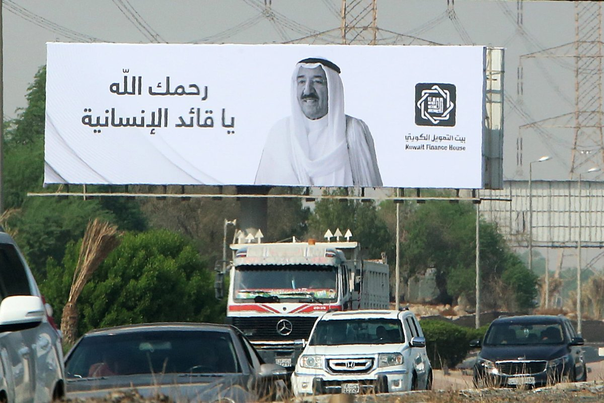 This picture taken on October 1, 2020 shows a billboard displaying the face of Kuwait's late emir Sheikh Sabah al-Ahmad al-Jaber al-Sabah with a message of condolences on his passing, along a main road in Kuwait City. [YASSER AL-ZAYYAT/AFP via Getty Images]