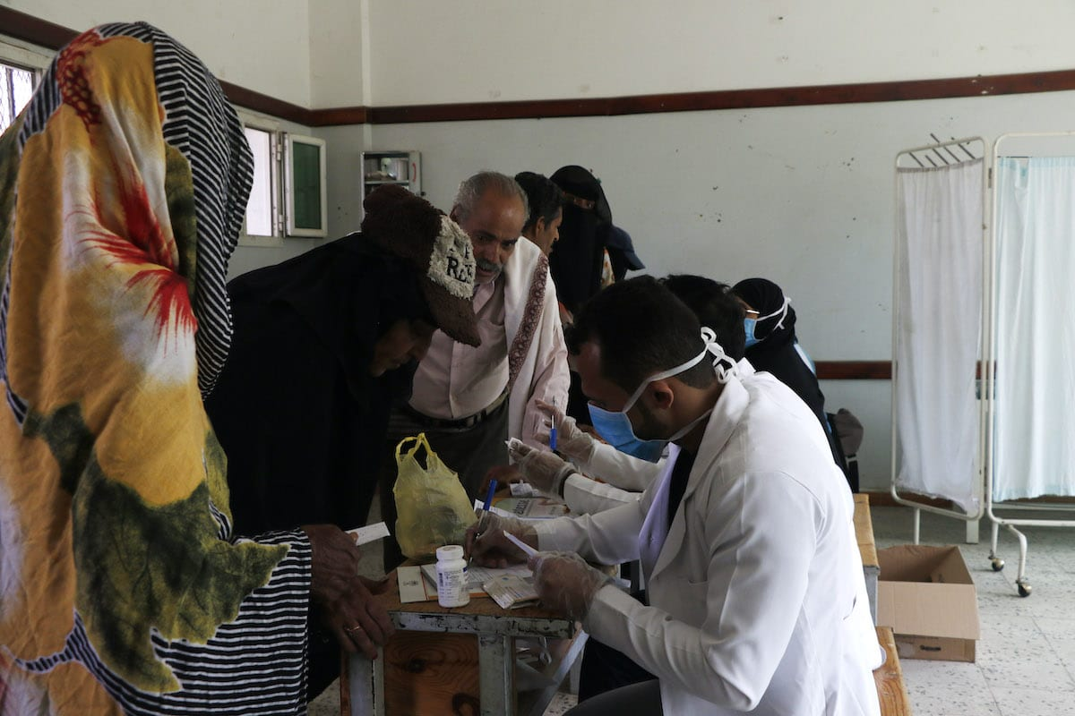 A volunteer doctor offers poor persons free medical treatments and medicines through an initiative staged by volunteer doctors on 9 July 2020 in Sanaa, Yemen. [Mohammed Hamoud/Getty Images]