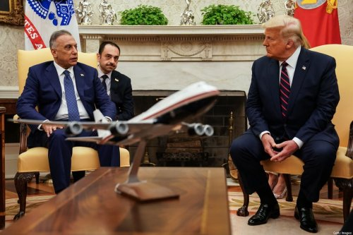 President Donald Trump (R) hosts Iraqi Prime Minister Mustafa Al-Kadhimi in the Oval Office at the White House 20 August 2020 [Anna Moneymaker-Pool/Getty Images]