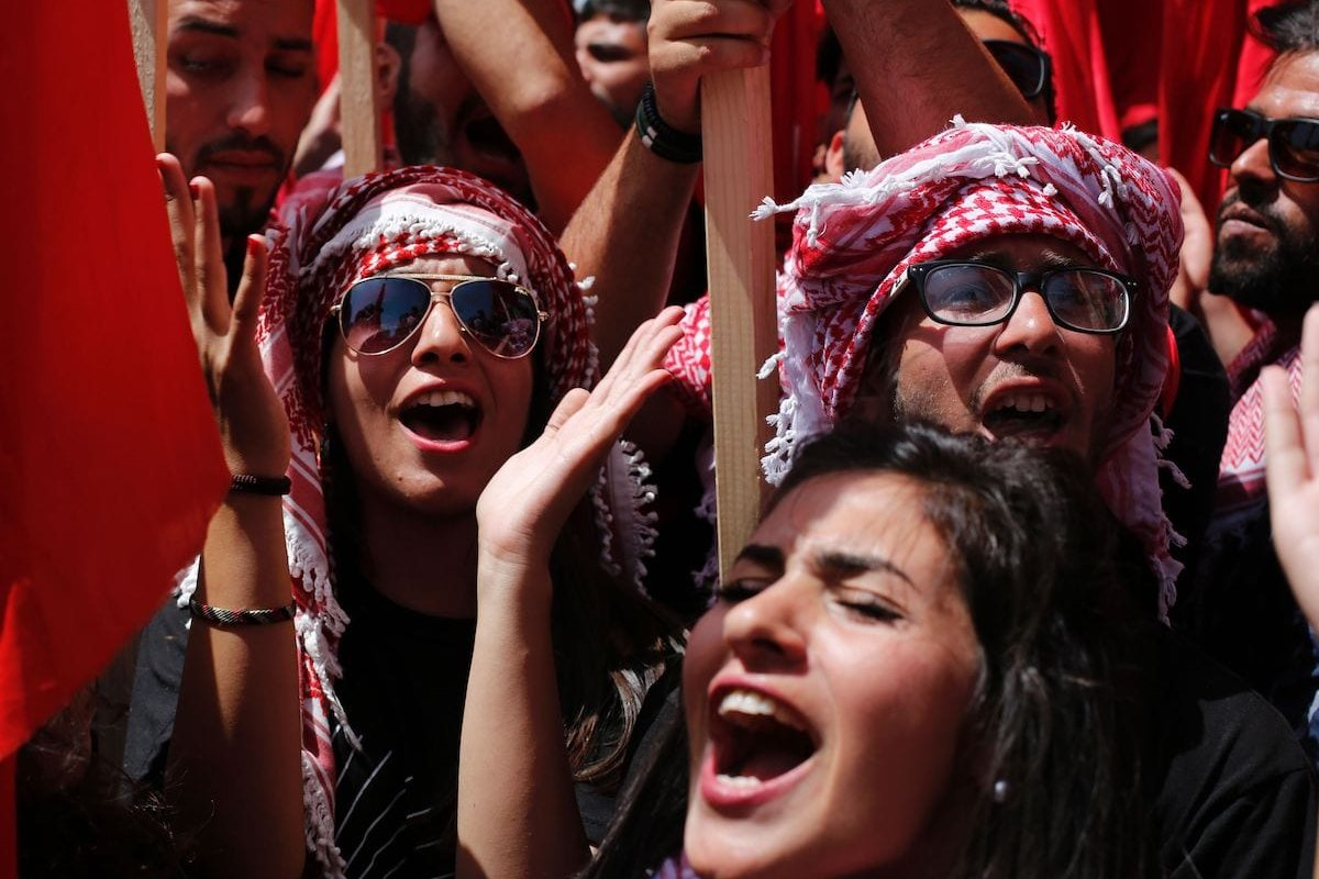 Palestinian students supporting the Popular Front for the Liberation of Palestine (PFLP) movement take part in a rally during an election campaign rally for the student council at the Birzeit University, near the West Bank city of Ramallah on 26 April 2016 [ABBAS MOMANI/AFP via Getty Images]