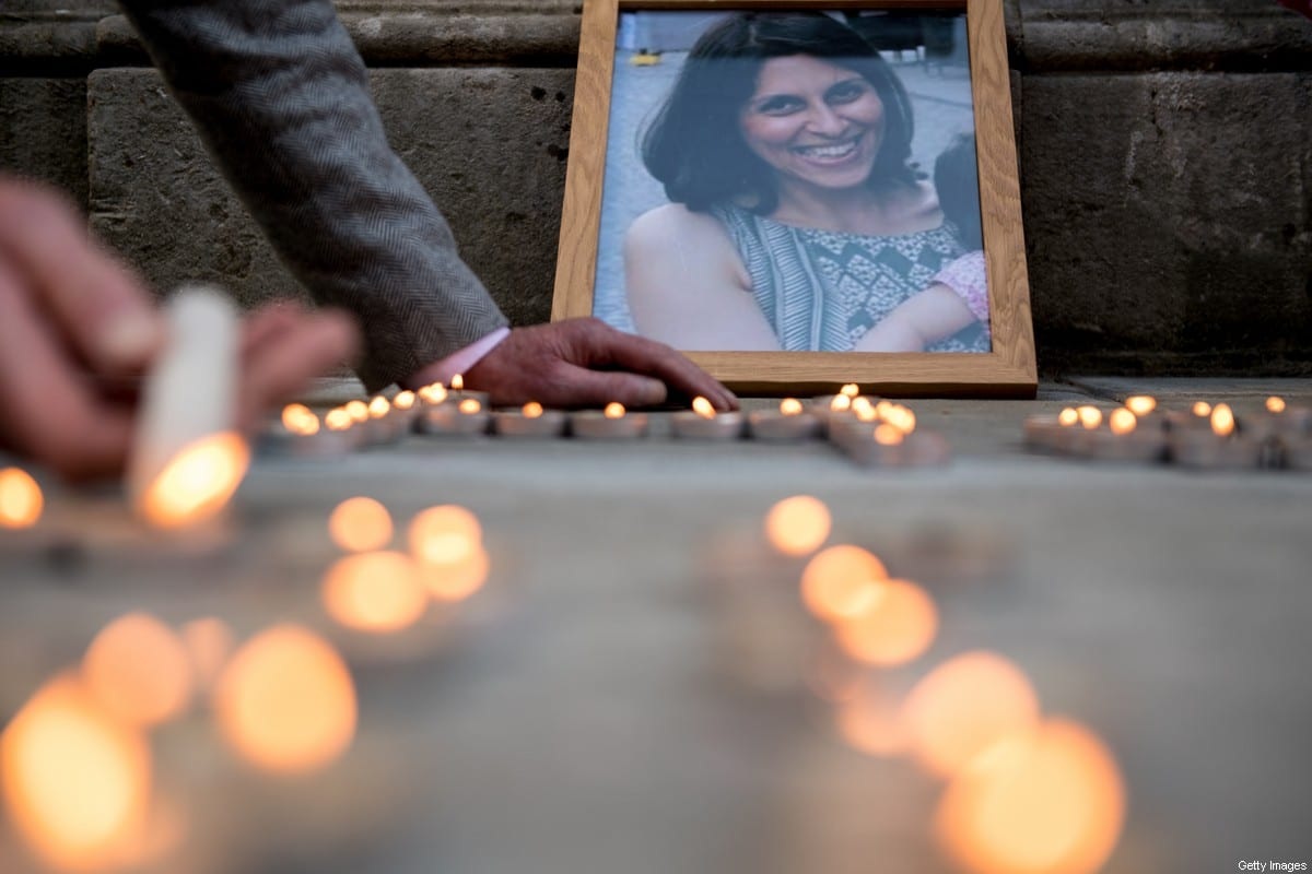 A photo of Nazanin Zaghari-Ratcliffe is seen amongst candles during a fourth birthday vigil for her daughter Gabriella opposite the Foreign & Commonwealth Office on June 11, 2018 in London, England [Chris J Ratcliffe/Getty Images]