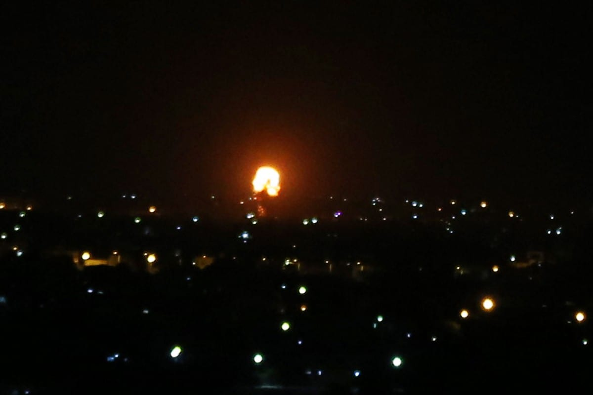 Explosion illuminates the night sky after Israeli warplanes hit farming areas in east of Deir al-Balah, Gaza on October 20, 2020 [Ashraf Amra/Anadolu Agency]