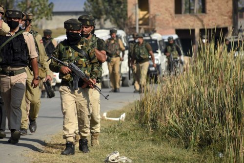 KASHMIR, INDIA-OCTOBER 05 : Indian policemen arrive at the spot of shootout on the outskirts of Srinagar on October 05, 2020.Two Indian Central Reserve Police Forces (CRPF) soldiers were killed and three others sustained injuries after suspected militants attacked a forces party at Kandizal area of Pampore in south Kashmir's Pulwama. ( Faisal Khan - Anadolu Agency )