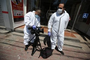 Photographers in protective clothing due to the coronavirus pandemic in Gaza, 26 November 2020 [Mohammed Asad/Middle East Monitor]