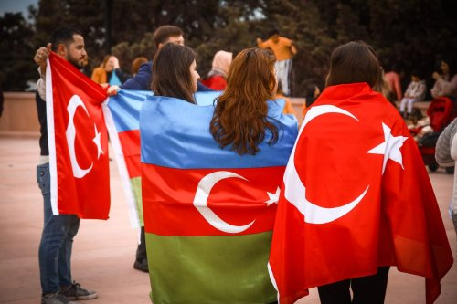 Azerbaijani and Turkey supporters celebrate the deal reached to halt fighting over the Nagorno-Karabakh region on 10 November 2020 [Resul Rehimov/Anadolu Agency]