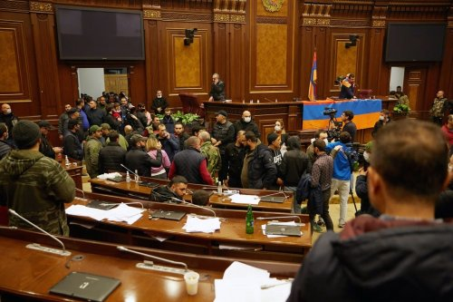 Protestors storm the Armenian parliament building after the announcement of a peace deal in the war between Armenia and Azerbaijan on 10 November 2020 [Alex McBride/Getty Images]