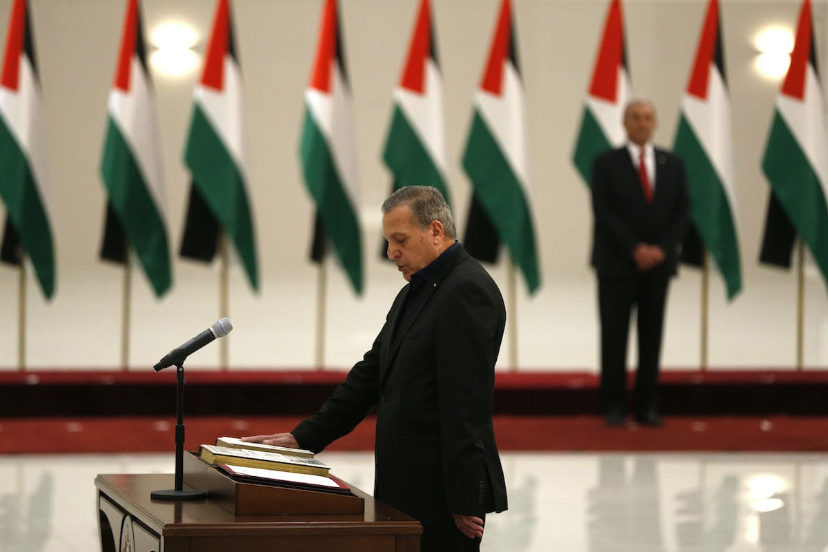 Nabil Abu Rudeineh is sworn in as a deputy Prime Minister and Minister of Information in the new Palestinian government, in the Israeli-occupied West Bank town of Ramallah, on 13 April 2019. [ABBAS MOMANI/AFP via Getty Images]
