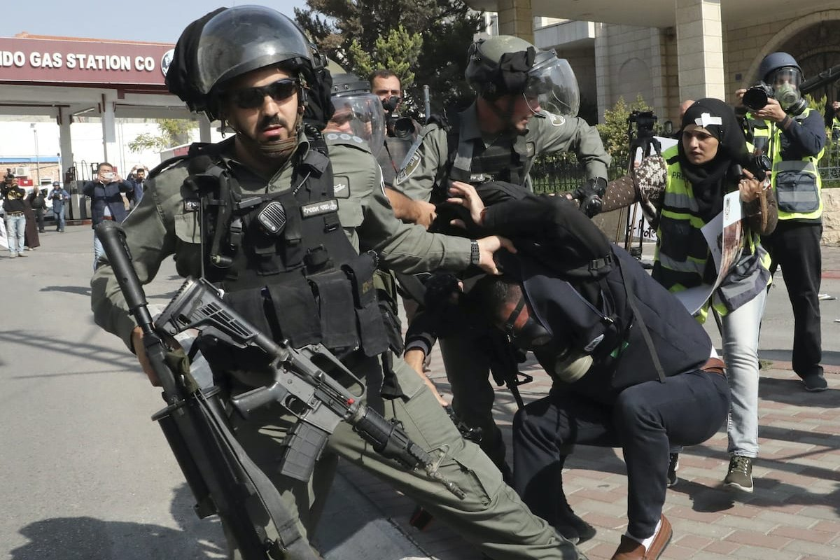 Israeli border guards detain a Palestinian journalist during a demonstration by Israel's controversial separation barrier in Bethlehem in the occupied West Bank on 17 November 2019 [HAZEM BADER/AFP via Getty Images]