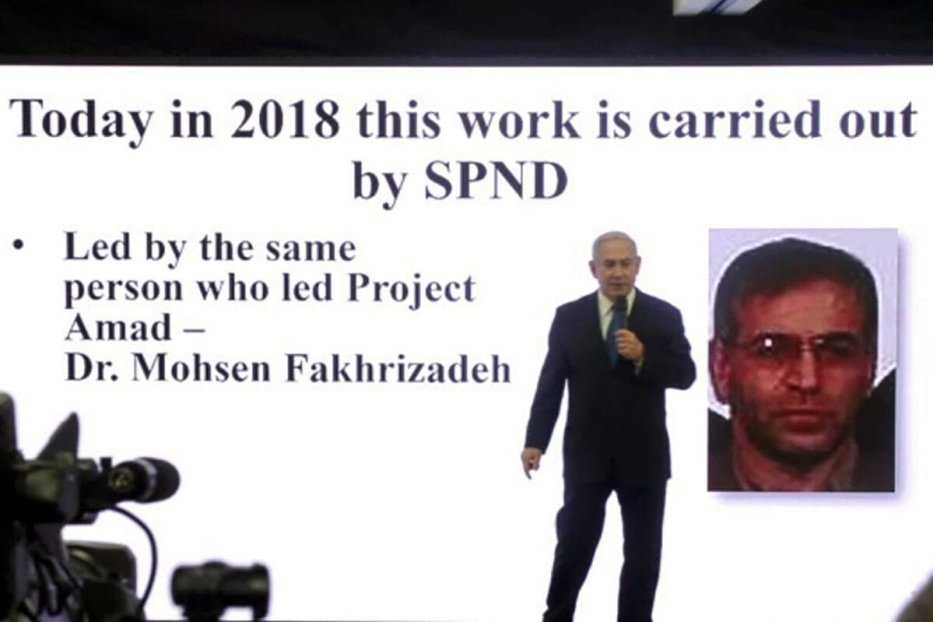 This image grab from an AFPTV video shot on April 30, 2018, shows Israeli Prime Minister Benjamin Netanyahu delivering a speech on Iran's nuclear program in Tel Aviv, with a slide behind him picturing Iranian scientist Mohsen Fakhrizadeh. - Iran said Fakhrizadeh, one of its most prominent nuclear scientists, was assassinated in an attack on his car outside Tehran that it accused arch foe Israel of being behind. (Photo by Nir KAFRI / AFP) (Photo by NIR KAFRI/AFP via Getty Images)