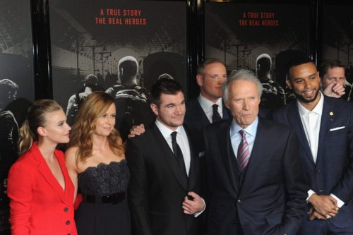 """BURBANK, CA - FEBRUARY 05: Actress Jeanne Goursaud, Jenna Fischer, Alek Skarlatos, Spencer Stone, Clint Eastwood and Anthony Sadler arrive for the Premiere Of Warner Bros. Pictures' """"The 15:17 To Paris"""" held at Steven J. Ross Theater/Warner Bros Studios Lot on February 5, 2018 in Burbank, California. (Photo by Albert L. Ortega/Getty Images)"""