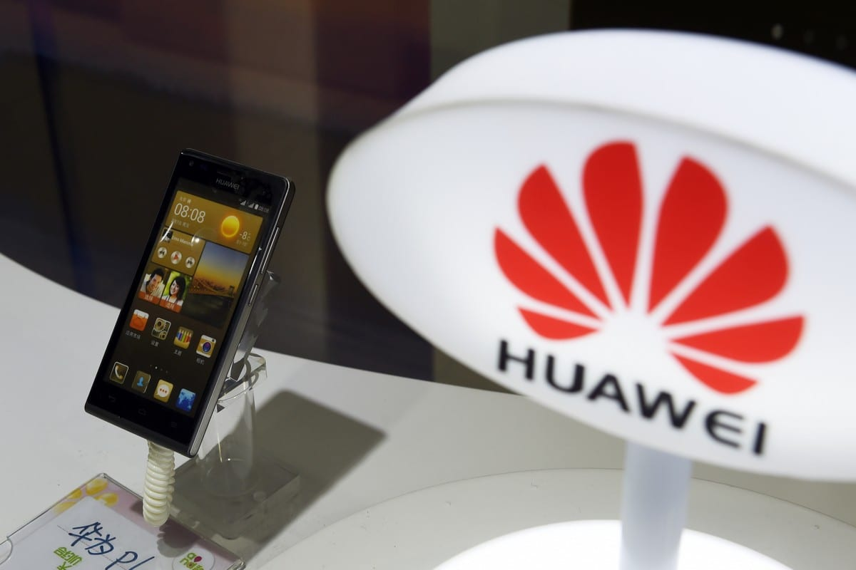 A mobile phone, made by telecom Huawei, is displayed in a store in Beijing on 2 August 2015 [GREG BAKER/AFP/Getty Images]