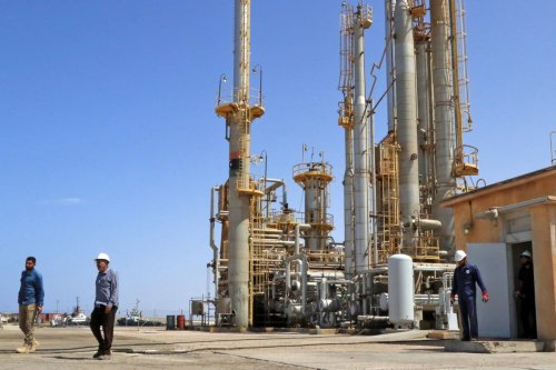 Workers at an oil port in Libya on 24 September 2020 [AFP/Getty Images]