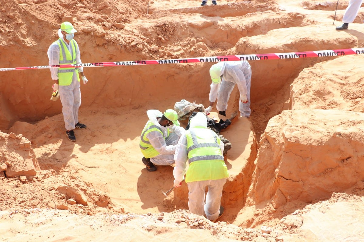 TARHUNAH, LIBYA - NOVEMBER 07: [EDITORS NOTE: Image depicts death] Forensic medicine officials conduct excavation works at a mass grave in Tarhunah, Libya on November 07, 2020. A large number of bodies of men and women have been found one after another in excavations since June. ( Mücahit Aydemir - Anadolu Agency )