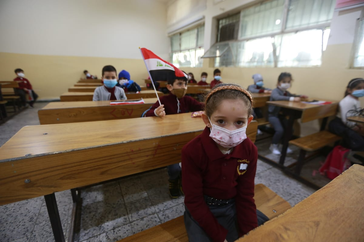 Primary school students seen with face masks on amidst the coronavirus pandemic, in Baghdad, Iraq on November 29, 2020 [Murtadha Al-Sudani / Anadolu Agency]