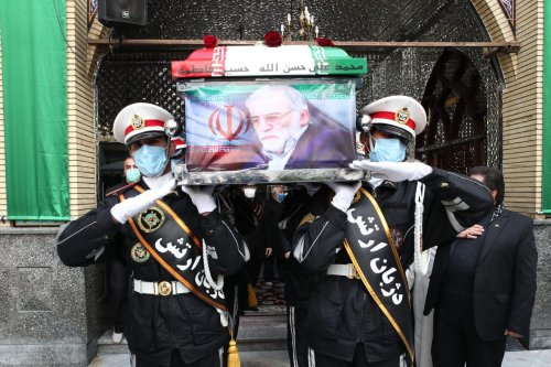 "TEHRAN, IRAN - NOVEMBER 30: (----EDITORIAL USE ONLY MANDATORY CREDIT - ""IRANIAN DEFENSE MINISTRY / HANDOUT"" - NO MARKETING NO ADVERTISING CAMPAIGNS - DISTRIBUTED AS A SERVICE TO CLIENTS----) Honor guards carry the flag-draped coffin of Iranian Top nuclear scientist, Mohsen Fakhrizadeh Mahabadi, during a funeral at Imamzadeh Saleh Shrine in Tehran, Iran on November 30, 2020. Fakhrizadeh, who headed research and innovation at the defense ministry, was killed by unidentified gunmen on the outskirts of the capital Tehran on Friday. ( Iranian Defense Ministry - Anadolu Agency )"
