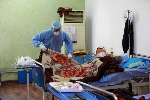 Covid-19 patients in a hospital in Iraq on 16 December 2020 [Murtadha Al-Sudani/Anadolu Agency]