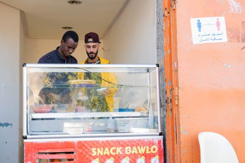 Men working at a restaurant is seen in Rabat, Morocco on December 14, 2020 [Jalal Morchidi/Anadolu Agency]