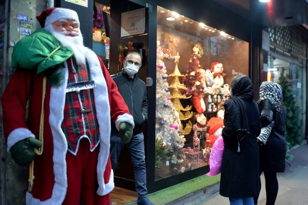 Shopers observe Christmas-themed window display of a store in a neighbourhood with a large Christian population in Tehran, Iran, on December 22, 2020 [Fatemeh Bahrami / Anadolu Agency]