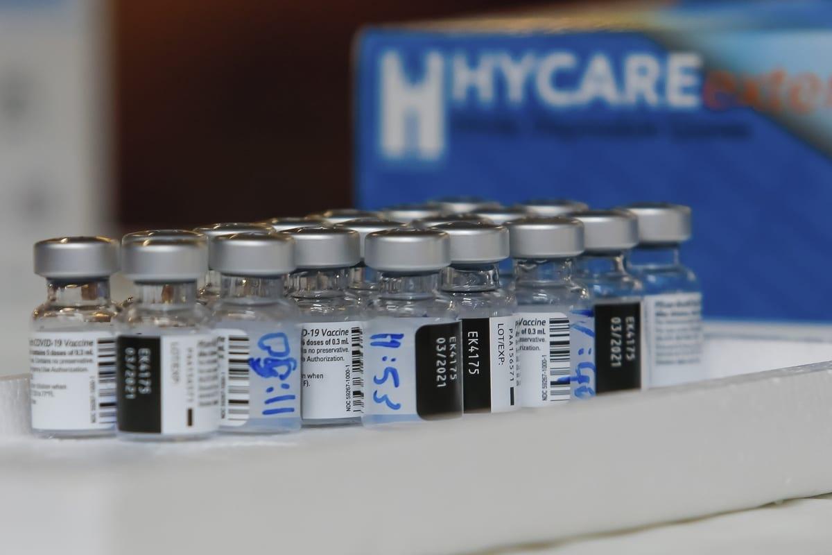 Galss bottles with Covid-19 vaccine are seen as elderly people and workers receive a Pfizer-BioNTech coronavirus (COVID-19) vaccine at Mishan Efal Nursing Home, in Tel Aviv, Israel on December 23, 2020 [Nir Keidar / Anadolu Agency]