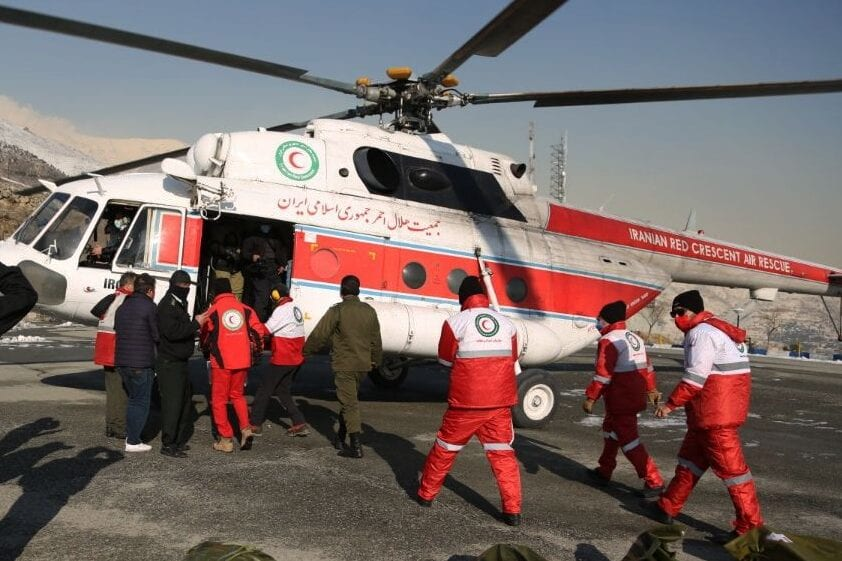 A helicopter joins the rescue operation after an avalanche claimed 8 lives in Shemiran, Iran on December 27, 2020 [Iranian Red Crescent Society / Anadolu Agency]
