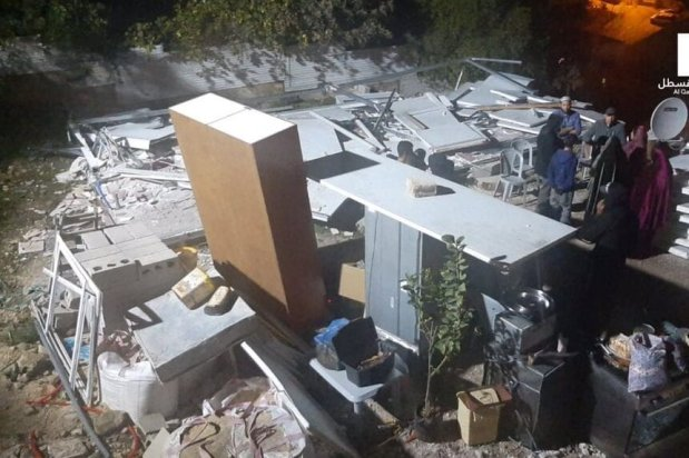 The Israeli municipality in occupied Jerusalem forced a Palestinian woman from the village of Silwan to demolish her house over claims that it lacked building licenses on 22 December 2020 [@48nnews /Twitter]