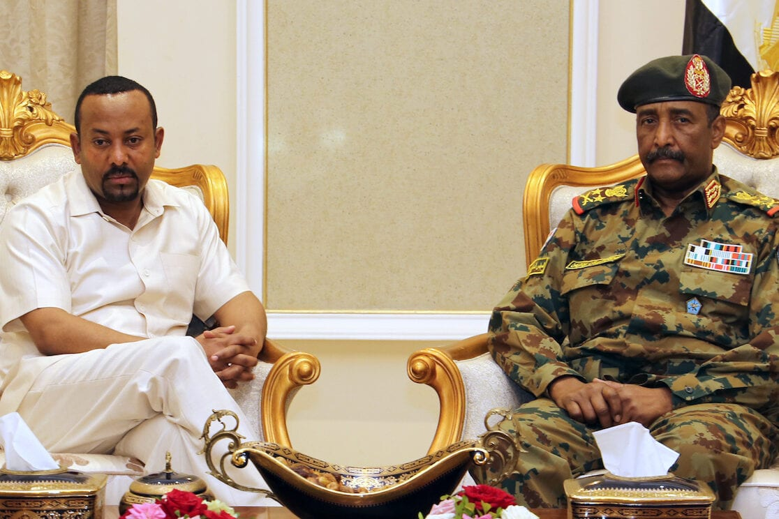 Ethiopia's Prime Minister Abiy Ahmed (L) meets with the chief of Sudan's ruling military council, General Abdel Fattah al-Burhan (R), in Khartoum on 7 June 2019. [AFP via Getty Images]