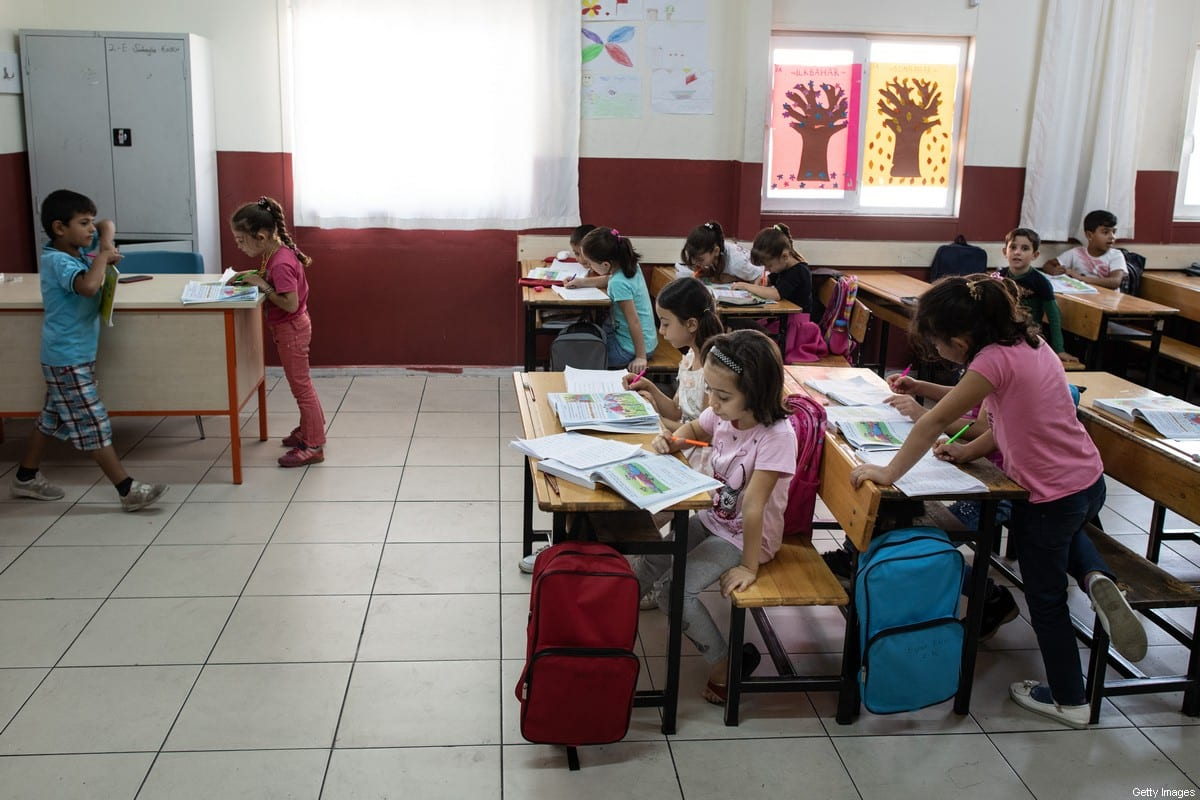 """KAHRAMANMARAS, TURKEY - SEPTEMBER 19: Syrian refugee children attend 2nd degree class at the Kahramanmaras refugee camp's school on September 19, 2019 in Kahramanmaras, Turkey. Turkey's president, Recep Tayyip Erdogan, is pushing for the creation of an expanded """"safe zone"""" in northern Syria where his government hopes to resettle up to three million Syrian refugees. The United States and Turkey recently started joint patrols of a small buffer zone along the border, but it's a far cry from the 20-by-300 mile strip proposed by Mr. Erdogan, and no other power involved in the war as agreed to the idea. Turkey has warned that, if it doesn't receive more international support for the safe zone, it might relax its migration controls and reopen the route for refugees to enter Europe. More than 3.6 million Syrian refugees have settled in Turkey after fleeing the civil war that began in 2011. (Photo by Burak Kara/Getty Images)"""