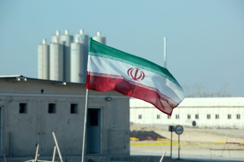 A picture taken on November 10, 2019, shows an Iranian flag in Iran's Bushehr nuclear power plant, during an official ceremony to kick-start works on a second reactor at the facility. - [ATTA KENARE/AFP via Getty Images]